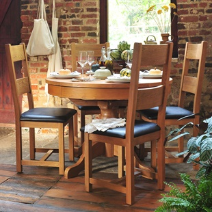 Oakland 110-145 Ext. Round Table and 4 Leather Seat Chairs